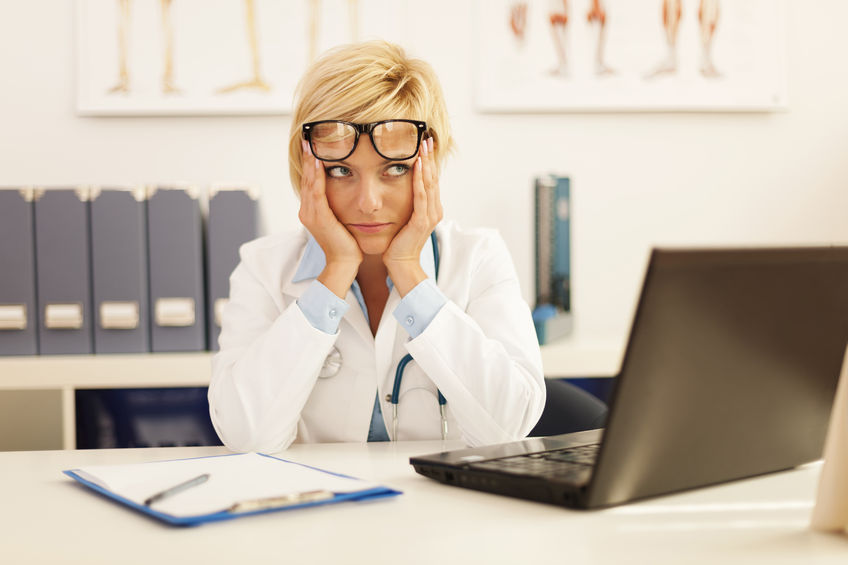 Desperate female doctor at computer