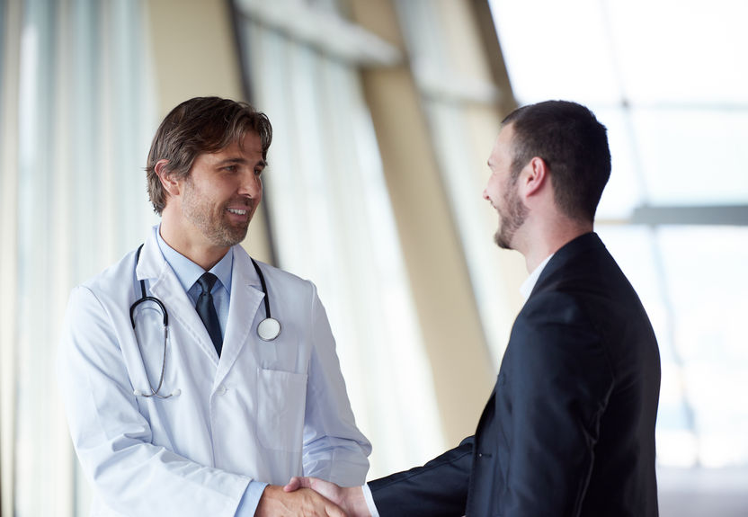 49138382 - doctor handshake with a patient at doctors bright modern office in hospital