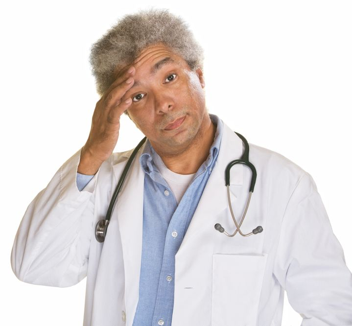 21305413 - concerned medical doctor with hand on forehead